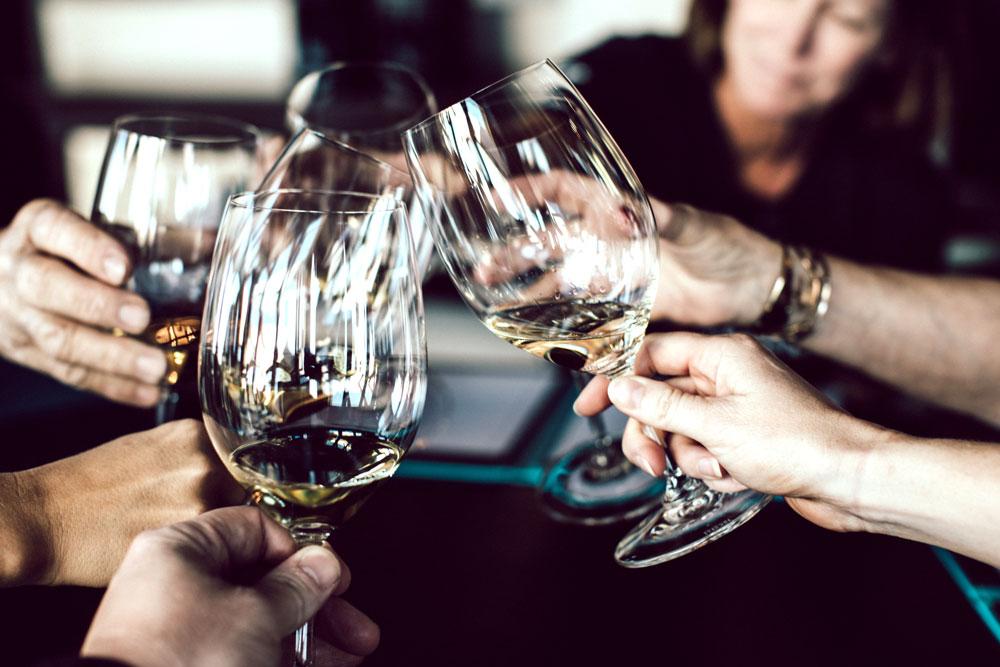Wine glasses being cheered