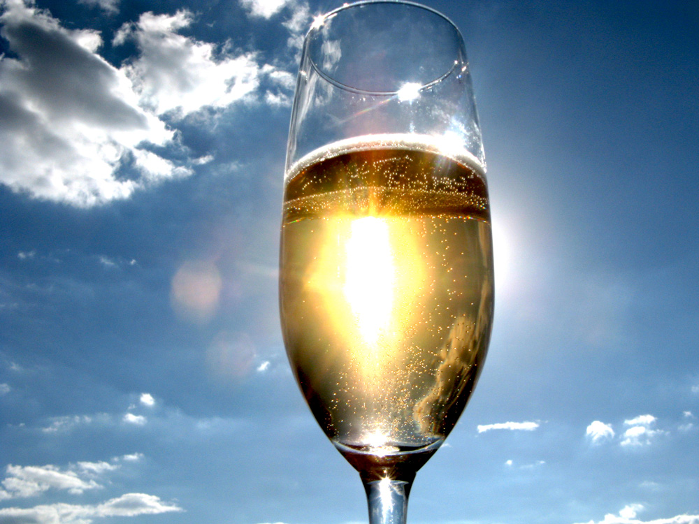 Sun shining through glass of wine