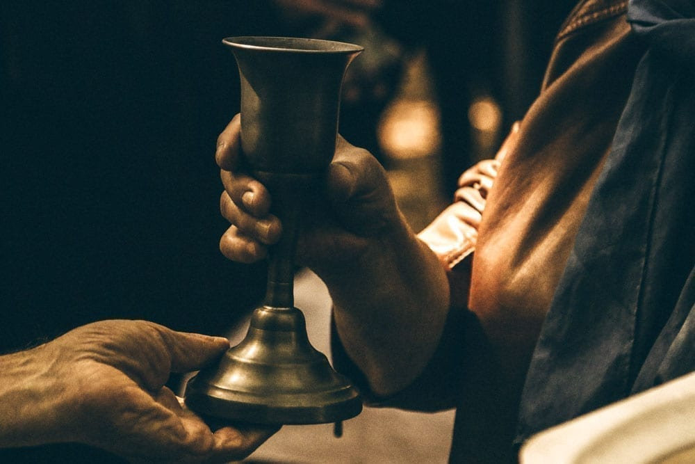 Person drinking from a goblet